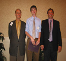 Jared Wilmoth (center) presented award by Charles & Charlie Bascom