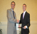 Center Assoc. Dir. Keith Chapes presents award to Parker Rayl