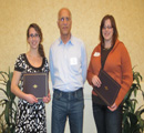 Council member Albert Perry presents awards to Chloe Callahan & Angela Grommet
