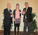 Katie George receives award from Sunny 102.5's Ken Jennison & John Anderson.