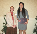 Stephanie Jacquez receives award from Assoc. Dean of Arts & Sci Beth Montelone.