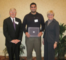 Faddy Khamis receives award from council members Mike & Elaine Jacobson.