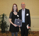 Jessica Long receives award from Dr. Lincoln Deihl.