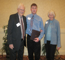 Christopher Larson receives an award from C. Clyde & Midge Jones.