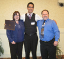 German Cuevas receives award from Jim & Tamra Johnson