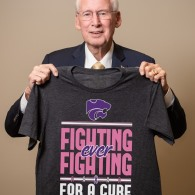 Coach Bill Snyder holding Fighting for a Cure shirt 2019